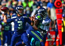 TRIBUNE PHOTO: MICHAEL WORKMAN - Seattle Seahawks quarterback Russell Wilson winds up for a pass in the NFL opener Sunday at CenturyLink Field.