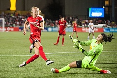 TRIBUNE PHOTO: DIEGO G. DIAZ - Portland Thorns midfielder Dagny Brynjarsdottir puts her shot past Western NY Flash goalkeeper Sabrina D'Angelo, giving the home team a 3-0 lead Sunday at Providence Park.