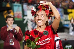 TRIBUNE PHOTO: DIEGO G. DIAZ - Dagny Brynjarsdottir of the Portland Thorns is awarded a crown of roses by the Rose City Riveters after Sunday's home victory.
