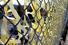 TIDINGS PHOTO: LESLIE PUGMIRE HOLE - West Linn Remembers Yellow Ribbon project was held last week during the 15th anniversary of the Sept. 11 attacks. Citizens were encouraged to stop on the A Street Bridge and add a yellow ribbon to the display, prominent to I-205 drivers.