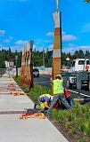 DAVID F. ASHTON - Workers bolt a new Sellwood Bridge public art totem - still suspended from a crane - into place.