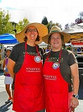 ELIZABETH USSHER GROFF - Emily Murnen (left) and Peggy McCafferty smile because they are improving security at their Farmers Markets equipment shed, sited on the Woodstock Key Bank parking lot.