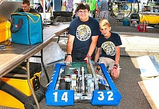 DAVID F. ASHTON - Showing off their robot are Alexandre Couchout and Caleb Eby of the Metal Beavers FIRST Robotics team, formerly based at Franklin High School.