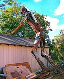 RITA A. LEONARD - This giant metal man leans over a garage roof at S.E. 79th and Raymond Street, near Marysville School. He was originally built as a television prop.