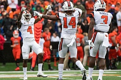 TRIBUNE PHOTO: JOSH KULLA - Oregon State defenders (from left) Dwayne Williams, Treson DeCould and Brandon Arnold celebrate a play during the Beavers' victory over Idaho State.