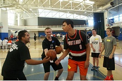 COURTESY PHOTO - Gabe Ellis (left), a coach at the recent Hoop Camp at Tualatin Hills Athletic Center, prepares for a jump ball with camper Nick Jackson.