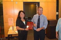 DANIEL PEARSON - Cindy Gonzalez, a custodian at Eccles Elementary, receives from Canby School District Superintendent Trip Goodall the September 2016 Canby Area Recognition of Excellence (C.A.R.E.) Award.