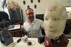 SPOKESMAN PHOTO: VERN UYETAKE - Emmy-winning special makeup effects artist and roboticist, Will Huff, with his robot ALAN in his workshop in Wilsonville.