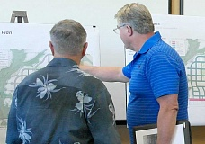 SPOKESMAN PHOTO: CLAIRE COLBY - Resident Gary Grill (left) looking at the street tree plan Sept. 14 at the Frog Pond open house.