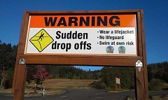 COURTESY PHOTO: TACEY SMITH - Four large signs, posted in highly visible spots at Hagg Lakes Sain Creek Picnic Area and Boat Ramp C, give this clear warning - at least to English speakers - of the deadly drop-offs hidden under the water. Two of them also offer free loaner life jackets.