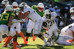 TRIBUNE PHOTO: JOSH KULLA - Running back Kyle Evans fights for yardage Saturday in Colorado's 41-38 win over Oregon at Autzen Stadium in Eugene.
