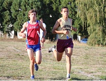 REVIEW/NEWS PHOTO: JIM BESEDA - La Salle Prep's Andy Krueger and Milwaukie's Juan Gudino set the early pace during Wednesday's Northwest Oregon Conference cross country meet at Clackamas Community College in Oregon City. Wilsonville's Nicholas Whitaker came on to win in 16:56.38.