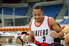 TRIBUNE PHOTO: DIEGO G. DIAZ - Trail Blazers guard CJ McCollum looks at material to autograph at Moda Center.