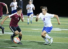 REVIEW/NEWS PHOTO: JIM BESEDA - La Salle Prep's Sean Hamel (right) tries to get around Crescent Valley's Mattin Khoshzaban during the second half of Tuesday's 1-1 tie at La Salle Prep in Milwaukie.