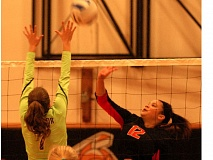 PAMPLIN MEDIA GROUP: MATT RAWLINGS - Gladstones D.J. Thompson sends an attack over the middle during Tuesdays three-set home loss to Estacada.