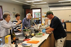 TIDINGS PHOTOS: PATRICK MALEE - Chef Danial James was on hand at the West Linn Adult Community Center Sept. 22 to teach residents how to make a stuff chicken dish.