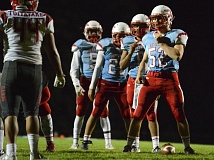 THE OUTLOOK: DAVID BALL - Centennial center Henry Button, 52, leads the Eagles to the line for a goal line play in Fridays 67-53 win over David Douglas.
