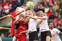 TRIBUNE PHOTO: JAIME VALDEZ - Three Western New York Flash players and two Portland Thorns, with Allie Long in the middle, battle for the ball in the air Sunday during their National Women's Soccer League semifinal match at Providence Park.