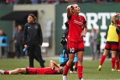 TRIBUNE PHOTO: JAIME VALDEZ - Allie Long (10) and the Portland Thorns show the effects of their 4-3 overtime playoff loss at home on Sunday to the Western New York Flash.