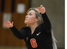 THE OUTLOOK: DAVID BALL - Saints libero Mikayln Almberg watches after keeping a ball alive with a bump during Fridays four-set win over Lane.