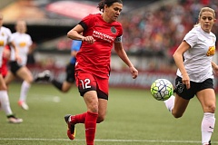 TRIBUNE PHOTO: JAIME VALDEZ - Forward Christine Sinclair heads into the Western New York Flash defense during Sunday's playoff game at Providence Park.