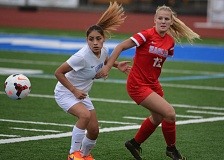 THE OUTLOOK: DAVID BALL - Centennials Rebecca Wheeler and Greshams Arianna Silva battle for a ball in the corner of the field during the Eagles 2-0 win Tuesday.