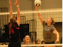 THE OUTLOOK: MATT RAWLINGS - Reynolds Josie Roberts swings through on a kill attempt during the Raiders three-set loss to Oregon City on Tuesday.