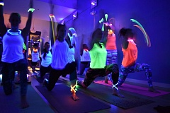 PAMPLIN MEDIA GROUP: JOSEPH GALLIVAN - The first Glow Yoga class at Om Yeah! Yoga in Northwest Portland was a sell out Wednesday. Black lights and EDM replaced the usual CFCs sitars.