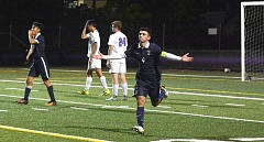 TIMES PHOTO: MATT SINGLEDECKER - Westview's Ryan Kister celebrates a goal during his team's 1-1 tie against Sunset at Sunset High School on Monday.