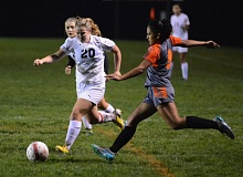 THE OUTLOOK: DAVID BALL - Corbetts Josie Fort charges onto a ball in front of Gladstones Jacia Pena during the second half of the Gladiators 2-1 win Thursday night.