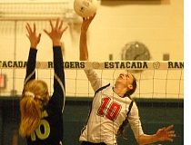 THE OUTLOOK: MATT RAWLINGS - Corbetts Faith McQueen attempts to get a kill past the block of Estacadas Trinity Gach during the Rangers home sweep Thursday night.