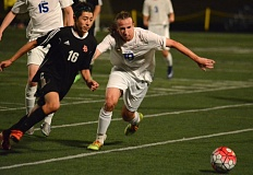THE OUTLOOK: DAVID BALL - The Scots Rigoberto Mendez looks to cut in front of Barlows Jonah McConnell for a loose ball in the midfield during David Douglass 4-0 win Thursday night.