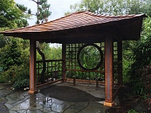 OUTLOOK PHOTO: JOSH KULLA - The worst damage to the garden was done to the 9-month-old Azumaya, a traditional Japanese summer pavilion. The bench was torn out and stolen.
