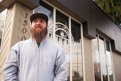 OUTLOOK PHOTO: JOSH KULLA - Tyler Walker, one of the owner/operators of Cannabis Nation, shows off the newly opened medical marijuana dispensary at the corner of Southeast Division and Burnside Road in Gresham.
