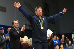 OUTLOOK PHOTO: JOSH KULLA - Olympic gold medalist and Barlow High School graduate Ryan Crouser shows off his medal Friday at a special homecoming ceremony held at Barlow to honor he and his cousin, Sam Crouser. Both men competed in the 2016 Olympic Games in Rio de Janeiro.