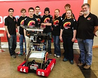 COURTESY PHOTO: TEAM SHOCKWAVE - A handful of team Shockwaves student members stand with their robot, flanked by coaches/mentors Jean Tenca (far left) and Chris Steiner (far right).