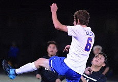 PAMPLIN MEDIA: DAVID BALL - La Salle defender Jack Gabrish clears a ball away in front of Sandy striker Ryan Escareno during the Falcons' 2-1 home win Tuesday night.