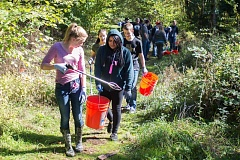 OUTLOOK PHOTO: JOSH KULLA - Springwater Trail High School students pick up trash Wednesday along the Springwater Corridor Trail.