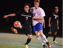 SANDY POST: DAVID BALL - Sandys Julian Carpenter settles a ball in the midfield in front of La Salle Preps Brendan Dexter during last weeks 2-1 road loss to the Falcons.