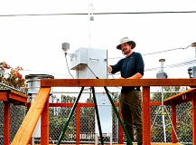 DAVID F. ASHTON - An Oregon DEQ worker checks on one of the air monitor devices at the new S.E. Harney Drive at 52nd monitoring station up the hill from the Precision Castparts facility.