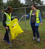 SUBMITTED PHOTO - Seniors Kobe Arnold and Emily Hunt pick up roadside litter during Gladstone High School's fourth annual day of service.