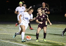 REVIEW/NEWS: JIM BESEDA - La Salle Prep's Lauren Nebels (12) looks to drive around Milwaukie's Santi Hart (2) during the second half of Tuesday's Northwest Oregon Conference girls' soccer game at La Salle Prep.