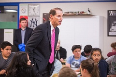 OUTLOOK PHOTO: JOSH KULLA - Oregon Senator Ron Wyden visited Dexter McCarty Middle School, with students, including Denise Chappell, preparing beforehand by putting signs on their desk with the issue concerning them most on the front and a related question on the back.