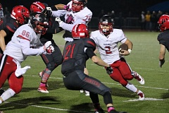 REVIEW/NEWS PHOTO: JIM BESEDA - Clackamas tailback Jacob McGreevy (2) rushed for 270 yards and three touchdowns to pace the Cavaliers to a 41-34 Mt. Hood Conference victory Friday.