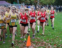 REVIEW/NEWS PHOTO: JIM BESEDA - Oregon City's Kaari Guelsdorf (779), Kylie Guelsdorf (780), Katie Schroeder (788) and Makenna Palumbo (786) head out from the start of Wednesday cross country meet at Lents Park in Portland.