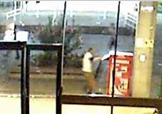 CONTRIBUTED PHOTO: GRESHAM PD - One of the suspects attempts to tip over a vending machine.