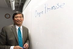 TRIBUNE PHOTO: JAIME VALDEZ - Portland Community College President Mark Mitsui stands next to 'Oregon Promise,' which he wrote on a white board. Oregon Promise is a program passed by the 2015 legistlature to offer community college for just $50 per term. The program is having an impact on Portland Community College's culture even though just 1,650 of its nearly 80,000 students are participating.