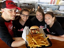 FILE PHOTO - Killer Burger staff display a delicious meal.