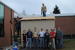 SUBMITTED PHOTO - Troy Jorgenson and Joe Bender with Dream Maker Bath and Kitchen (back row left to right) and Jacob Morgan, Tatiana Bender, Bill Bench, Levi Jorgenson, Tony Nelson, Anndee Jorgenson, James Shingleton, Alan Anderson and Eli Richardson (left to right) helped construct the storage shed Saturday.