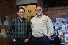 SPOTLIGHT PHOTO: NICOLE THILL - Dan Brown, left, and Jim Tierney, right, stand together in the lobby of the Community Action Team office in St. Helens. Brown will take over as the executive director of CAT next week as Tierney retires.